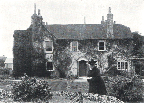 Charlotte Yonge in the front garden of her house, Elderfield, in Otterbourne.